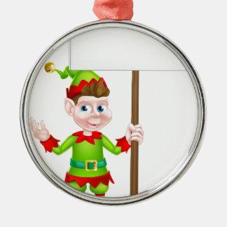 Duende del navidad que lleva a cabo la muestra adorno navideño redondo de metal
