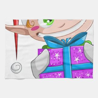 Duende del navidad que lleva a cabo un presente toalla de mano