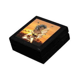 Duende en la caja de regalo de la oscuridad