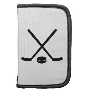 Duende malicioso de los palillos de hockey planificador