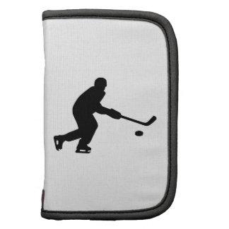 Duende malicioso del jugador de hockey organizadores