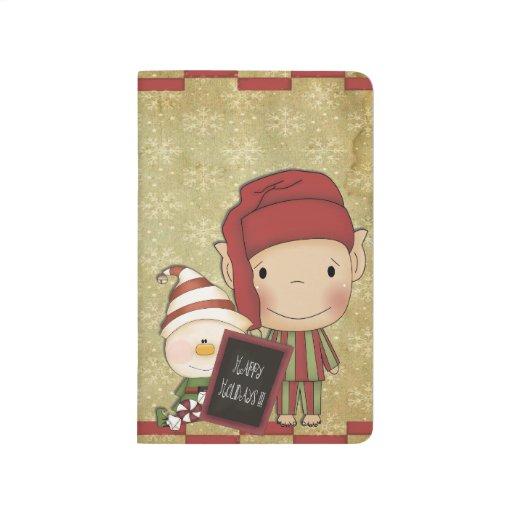Duende y muñeco de nieve con una muestra feliz del cuaderno