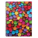 Dulces coloridos del caramelo del arco iris libretas