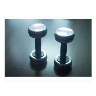 Dumbbell gym metal weights in gym health club postcard