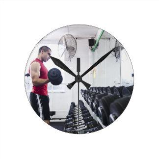 Dumbbells 2 round wall clocks