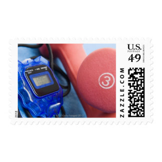 Dumbbells and stopwatch postage stamp