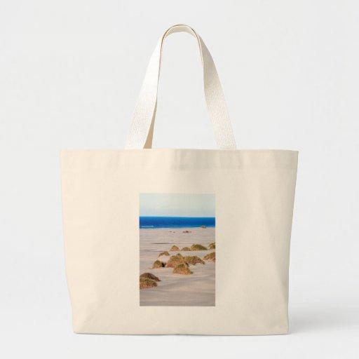 Dunas de arena y escupitajo de despedida de la hie bolsa