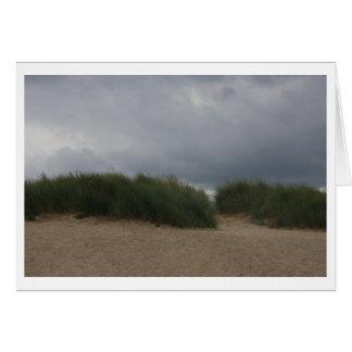 Dunes in cloudy sky card