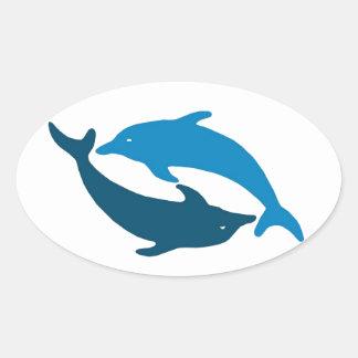 Dúo azul del delfín pegatina ovalada