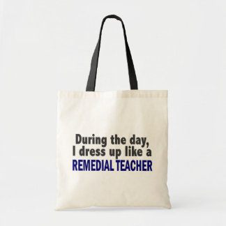 During The Day I Dress Up Like A Remedial Teacher Tote Bags