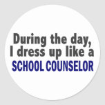 During The Day I Dress Up Like A School Counselor Round Stickers