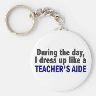 During The Day I Dress Up Like A Teacher s Aide Key Chain