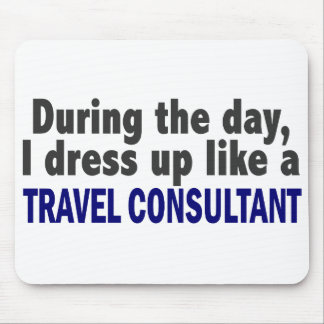 During The Day I Dress Up Like A Travel Consultant Mousepads
