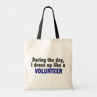 During The Day I Dress Up Like A Volunteer Tote Bags