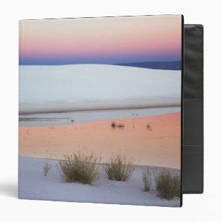 Dusk sky reflected in pool of water from vinyl binder