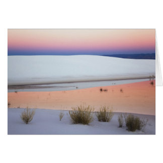 Dusk sky reflected in pool of water from greeting card