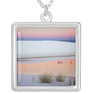 Dusk sky reflected in pool of water from square pendant necklace