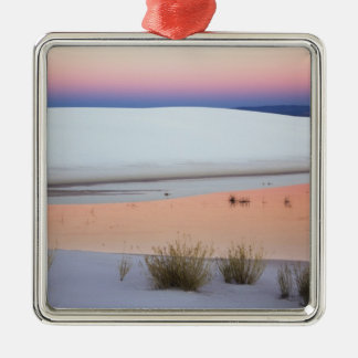 Dusk sky reflected in pool of water from square metal christmas ornament