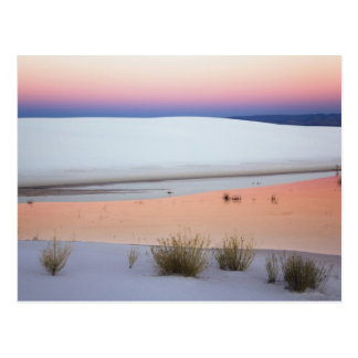 Dusk sky reflected in pool of water from postcard