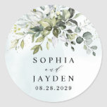 """Dusty Blue Eucalyptus Greenery Succulent Wedding Classic Round Sticker<br><div class=""""desc"""">This design is available with two different dusty blue shades. One option is more dustier than the other and leans towards a gray-dusty blue. This one that you are currently viewing leans more towards blue for the watercolor splashes. Compare each on-screen preview for a perfect match when it comes to...</div>"""