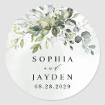 """Dusty Blue Eucalyptus Greenery Succulent Wedding Classic Round Sticker<br><div class=""""desc"""">Design features a bouquet of watercolor greenery,  eucalyptus and a succulent over a dusty blue watercolor splash. Design also features specks of painted (printed) gold and green. View the collection link on this page to see all of the matching items in this beautiful design.</div>"""