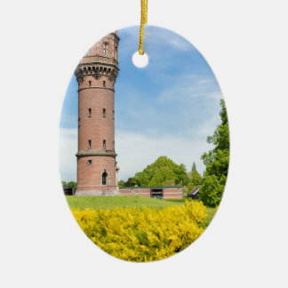 Dutch stone water tower with yellow broom flowers ceramic ornament