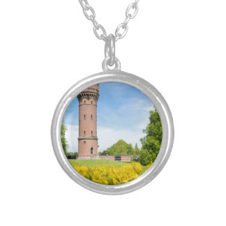 Dutch stone water tower with yellow broom flowers round pendant necklace