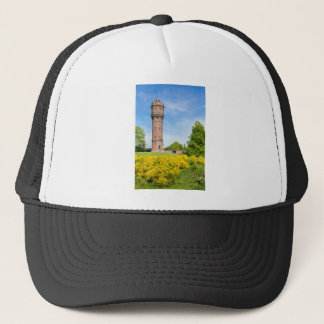 Dutch stone water tower with yellow broom flowers trucker hat