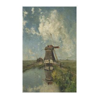 Dutch windmill on polder waterway Paul Gabriël Canvas Print