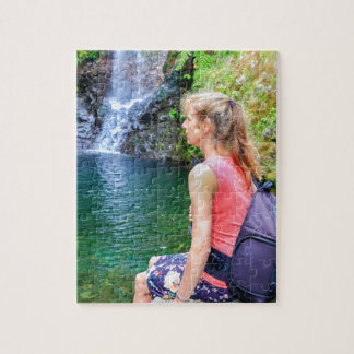 Dutch woman sitting on rock near waterfall jigsaw puzzle