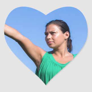 Dutch woman throwing boomerang in blue sky heart sticker