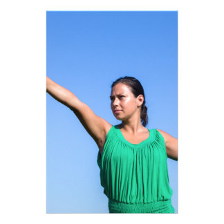 Dutch woman throwing boomerang in blue sky stationery