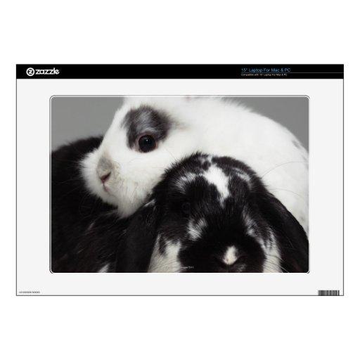 Dwarf-eared rabbit leaning over lop-eared laptop skin