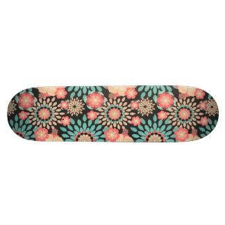 Dynamic blooming floral pattern on dark background skateboard