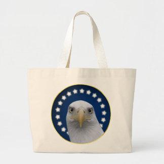 Eagle calvo americano con las estrellas bolsas
