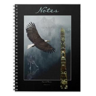 Eagle calvo que vuela, lobos y cuaderno del tótem