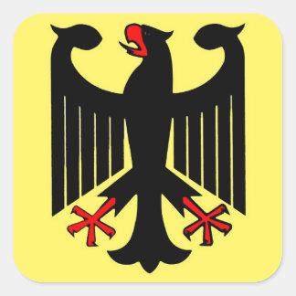 Eagle negro federal alemán en el escudo amarillo pegatina cuadrada