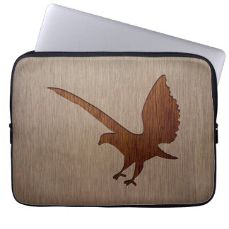 Eagle silhouette engraved on wood effect computer sleeve
