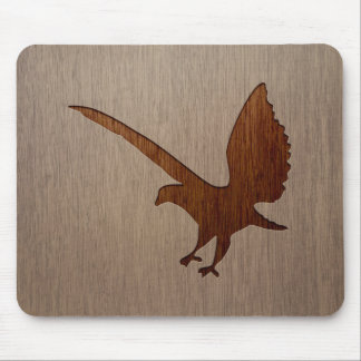 Eagle silhouette engraved on wood effect mouse pad
