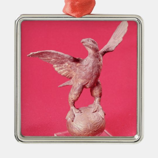 Eagle with spread wings on a ball metal ornament