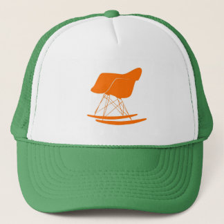 Eames rocker chair in orange trucker hat