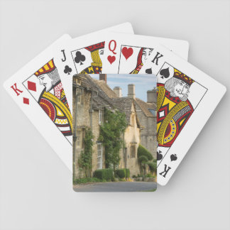 Early morning over connected cottages playing cards
