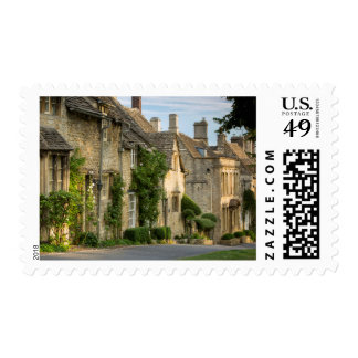 Early morning over connected cottages stamp