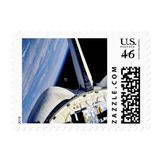 Earth and Moon Behind Discovery Postage