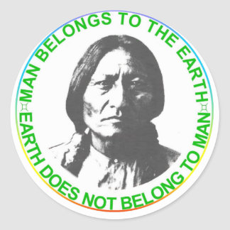 Earth does not belong to man classic round sticker