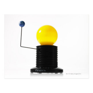 Earth rotating sun model on white background postcard