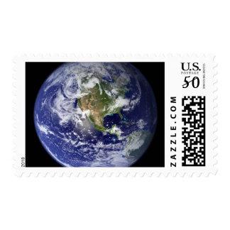 Earth showing the western hemisphere postage