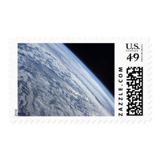 Earth's horizon against the blackness of space postage stamps