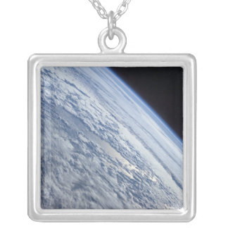 Earth's horizon against the blackness of space silver plated necklace