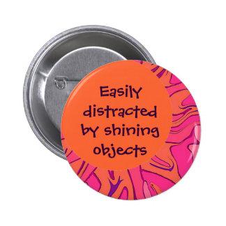 Easily distracted joke pinback button